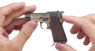 Beretta Pistol, M1934 miniature model in hand