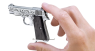 Beretta Pistol, M1934 decorated miniature model in hand