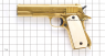 Colt М 1911 A1 Pistol, gold-plated miniature model on scale grid