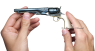 Colt Army Revolver with ivory grip plates, M1860 miniature model in hand