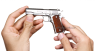 Colt М1911 A1 Pistol, nickel-plated miniature model in hand