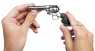 Colt Scout Revolver, short-barreled nickel-plated, M1873 miniature model in hand