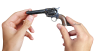 Colt Scout Revolver, M1873 miniature model in hand