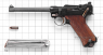 Navy Borchardt-Luger Pistol, M1904 miniature model on scale grid