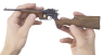 Mauser Pistol-Caliber Carbine 1896 miniature model, with a wild boar head image in hand