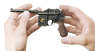 Mauser M712 Pistol miniature model in hand