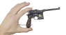 Mauser C-96 Pistol, decorated miniature model in hand