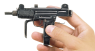 Submachine Gun Mini Uzi, M1981 miniature model in hand