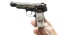 Stechkin APS Pistol, M1951 miniature model decorated with diamonds in hand
