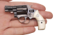Smith & Wesson, model #10, M1957 miniature model in hand